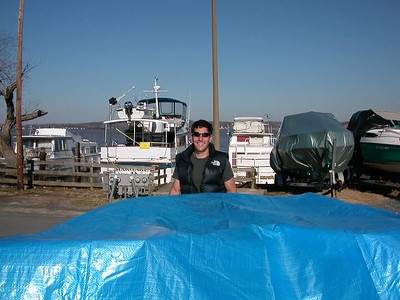 We found it!  Since it had more water in it than was in the river, Gary decides to install a better cover.  Anyone know why those tarps are always blue? 9 Mar 2003