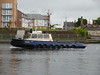 Clyde Marine's tug BITER heads downriver after helping out at the fetival site.