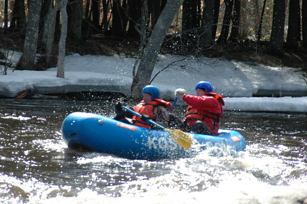 This is a whitewater raft trip on the Peshtigo River.  The first sequence was Saturday 1 Apr and the second was Sunday 2 Apr.  On Monday, the river was mostly iced over (lakes are still ice there).  The river slowly opened up with high water blowing out the last ice shelf Friday night.  The water was near freezing temperature and the air not much better.<br /> <br /> This picture shows Craig and Bryan lined up to go over a falls.