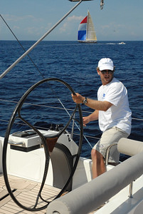 Andy Green, former GBR America's Cup helmsman at the wheel of Salperton.