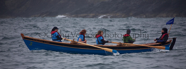 Racing as part of the Aberdeen Asset Management Portsoy Wooden Boat Festival held off the coast of Scotland in 2012. Traditional boats took part in a variety of both rowing and sailing races, including a Mackerel Race where the yachts sailed out to a boat to take a Mackerel suspended from a rod and line, and then return to the finish with the fish intact. Cathy Vercoe LuvMyBoat.com