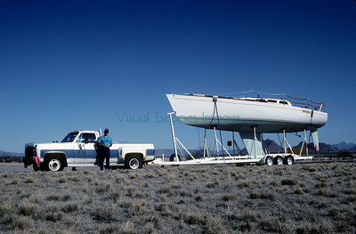 Have boat will travel. Old NM rodeo truck turns yacht hauler.