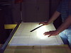 "The plans are reviewed and full size paper templates of cross sections (called ""stations"") of the hull are created.<br /> <br /> A light table is fashioned to facilitate accurate drawing and copying of each station."