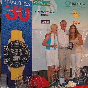 Bill Sweetser, owner of J109, Rush, Annapolis MD, accepts the Nautica watch and 1st place trophy from Linda C. and Marcie of Nautica Inc.