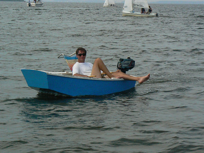 My favorite human interest photo this year.  An Opti turned into a little motor boat... how cool is that!