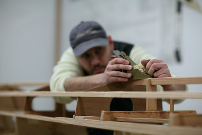 A #3 hand plane quickly and accurately fairs the keel and battens in preparation for the skin.