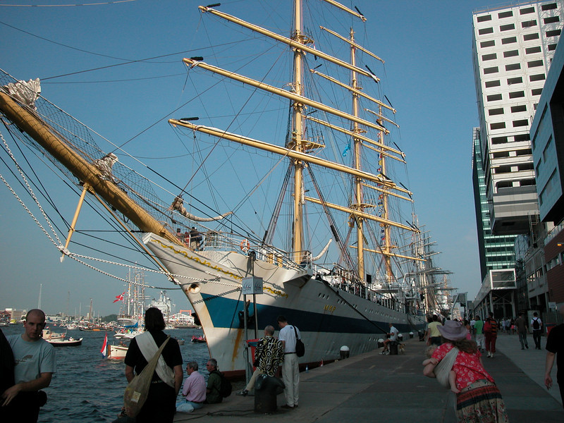 What a contrast: a classic Tall Ship next to a modern building...