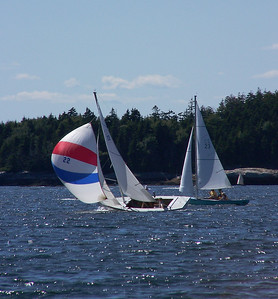 Small Point Sailing Club, boat number 22 with spinnaker or 'chute'  up, boat number 23 to the right, Phippsburg Maine ,photograph, image, photography, Vacationland, sailing race, Small Point Sailing Club