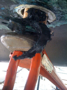 Excessive use of caulking to compensate for too large a hole for the thru-hull used.