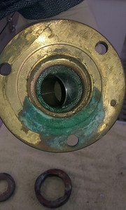 Green on bronze at flange is evidence of leaking flange