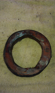 Wood rings that appeared to be hand hewed were used as spacers between conventional, nutted thru-hulls, and flanged sea cocks.
