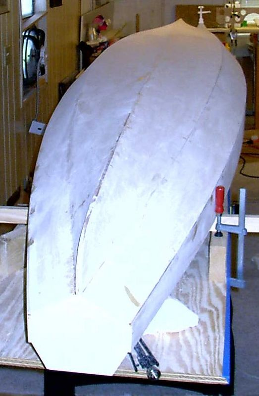 The hull seams have been tabed with epoxy and the stitches removed.