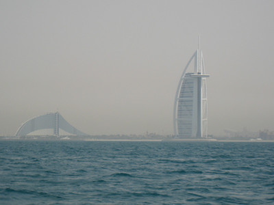 The Burj al Arab on the right and the Jumeirah Beach hotel on the left.