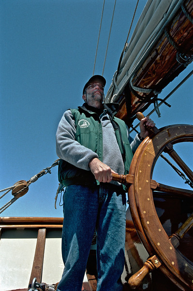 Phil at the Helm, Pride of Baltimore II, enroute to Bermuda