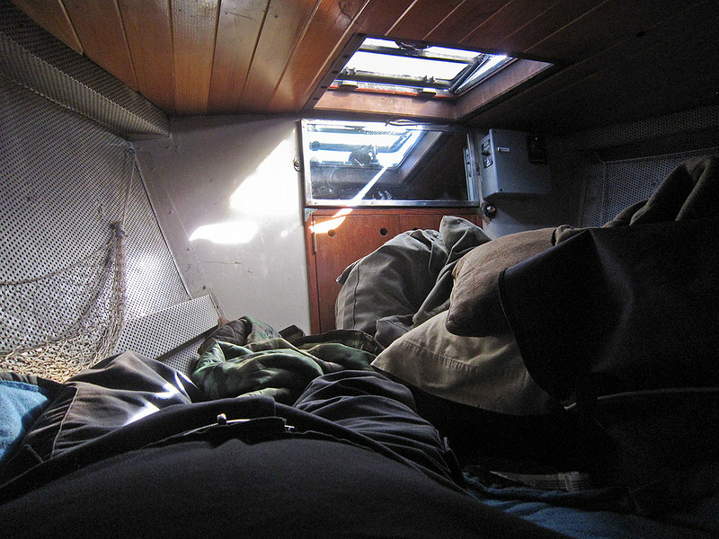 ps_2714  My bunk in the v-berth.  Luckily for me we were starboard tack so I could wedge up against the hull and pull a couple seabags next to me to hold me in place as we rocked and rolled eastbound.