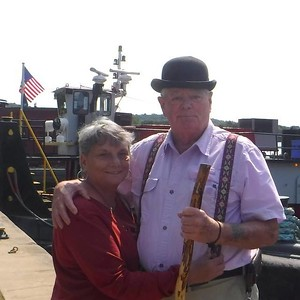 "Mark ""Woody"" Woods and his soulmate Marie creator of this web site. Items available  onnthis site with tugboat pictures 15 oz mug' 11 oz mug playing cards puzzles mouse pads ,"