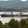 10/26/18 at 10:15 hd hrs I catch bulk carrier Intermarine's Industrial Strength inbound for Rennsselaer NY. Lots of cargo lashed on deck, looks like wind turbine parts. 147 m = 161 yards or 1 1/2 football fields long. Some profiles visable on the bridge