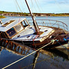 Flooded motor cruiser at Strangford harbour, County Down