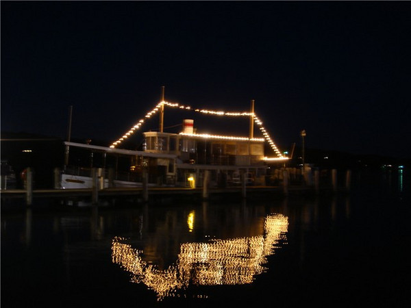 The Steam Yacht Louise lit up at night in celebration of your party or outing.