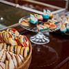 Desert buffet on Steam Yacht Louise's mahogany buffet.  Sailboat cookies & cupcakes by Bodi's Bake Shop