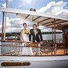 Bride and Groom on the bow of the Steam Yacht Louise.  Floral arrangement by Frontier Flowers.  Bride's dress by Christy's Bridal.  Groom's Blazer from Flemings.  Photo courtesy of Matt Mason Photography.