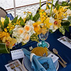 Table Linens by Carousel Linens, floral arrangement by Frontier Flowers, glassware & votives by Cornerstone Shop, place cards and stationary by Creative Element.