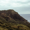 Looking across Pitcairn towards Fletcher Christians cave which he used as a lookout point.