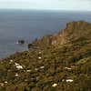 """Adanmstown, Pitcairn. You can just make out """"High Energy"""" anchored off the bay."""