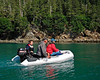 ps_1213 The crew of Ragtime, with Ian at the helm, going for a dinghy putt out of Tonsina Bay
