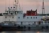 Tug Pat Lyall docking barge at Moosonee.