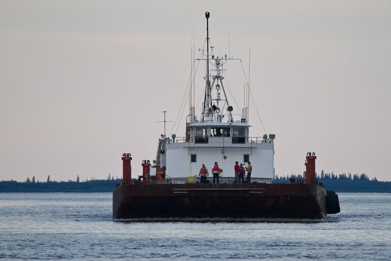 Tug Pat Lyall and barge arriving at Moosonee.