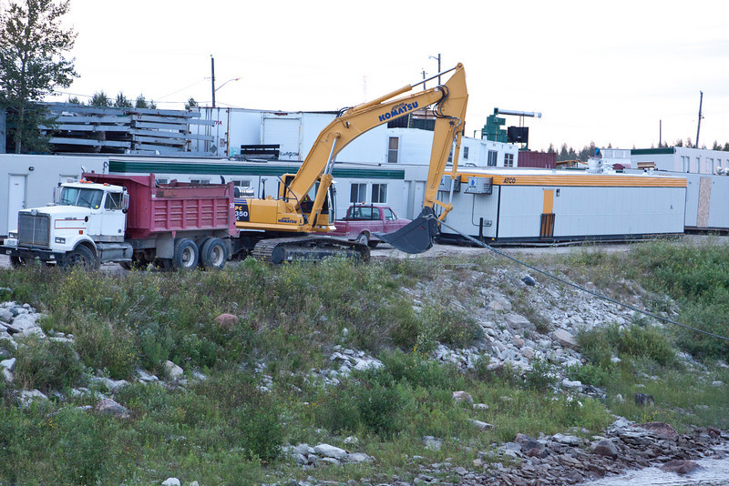 Heavy equipment on shore used to help dock barge brought by tug Pat Lyall.