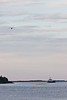 Tug Pat Lyall and barge overflown by aircraft on its entry to Moosonee.