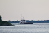 Tug Pat Lyall and barge coming into view from Moosonee.