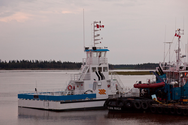 View of stern of new Ontario Northland barge Niska I beside tug Nelson River at Moosonee on the Moose River.