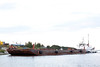 Tug Pat Lyall and barge in Moosonee. This image exposed to show details of barge.