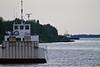 Barge Manitou II in foreground as tug Pat Lyall brings a barge to Moosonee.