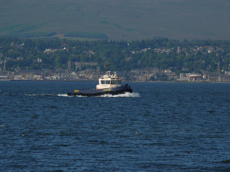 Clyde Marine tug BRUISER heads home after assisting ARTEMIS at Greenock.<br /> 11th July 2009