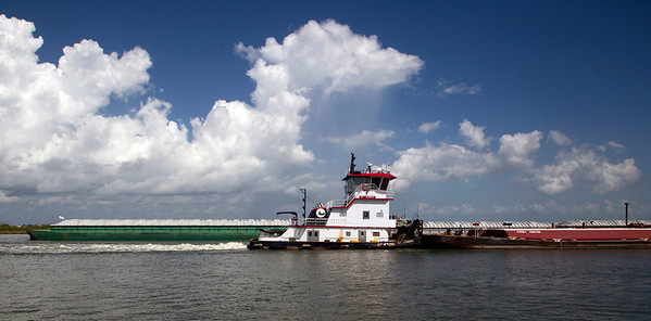 The Intracoastal Waterway runs up the west side of Bolivar Peninsula.  Here two large barges pass in opposite directions.