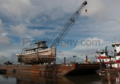 USS Tutahaco on barge ready to be shipped to scrap yard in Texas