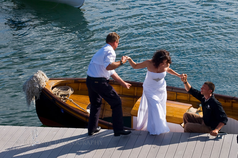 Married at Sea. The newlyweds come ashore to celebrate at the WoodenBoat School during the Windjammer Rendezvous in Brooklin Maine. Notice the champagne glasses on the dock.