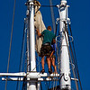 "Two crew members working aloft on the vessel Nathaniel Bowditch. The Nathaniel Bowditch was built as a racing yacht in 1922 in East Boothbay, Maine. This 82' windjammer accomodates 24 guests. More info at  <a href=""http://www.windjammervacation.com"">http://www.windjammervacation.com</a>."