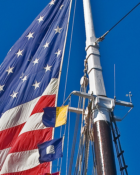Old Glory flying high above the Windjammer Victory Chimes.