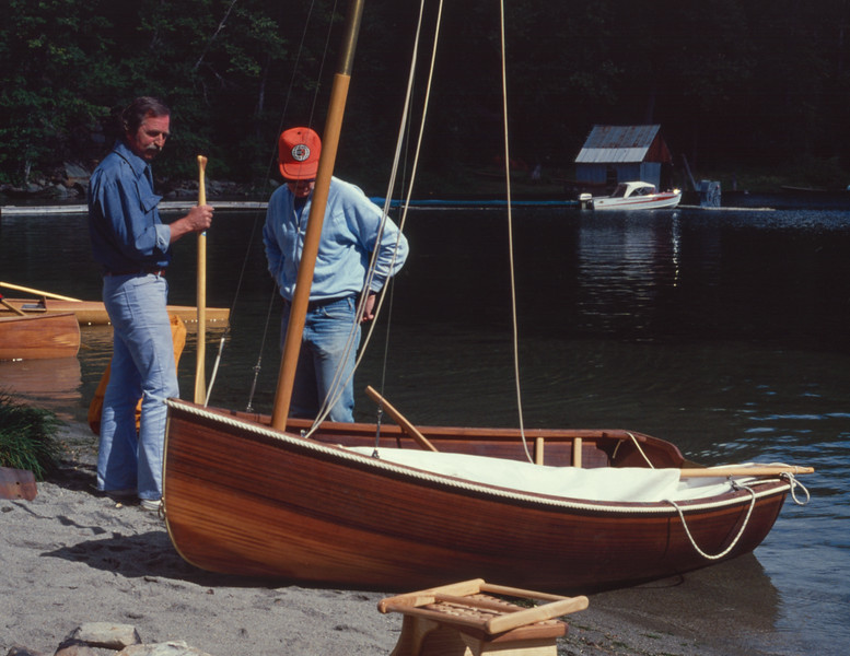 Ray Wonacott (left) demonstrating a cedar strip dinghy. Wonacott factory picnic, Lake Wenatchee, Washington, fall 1978.