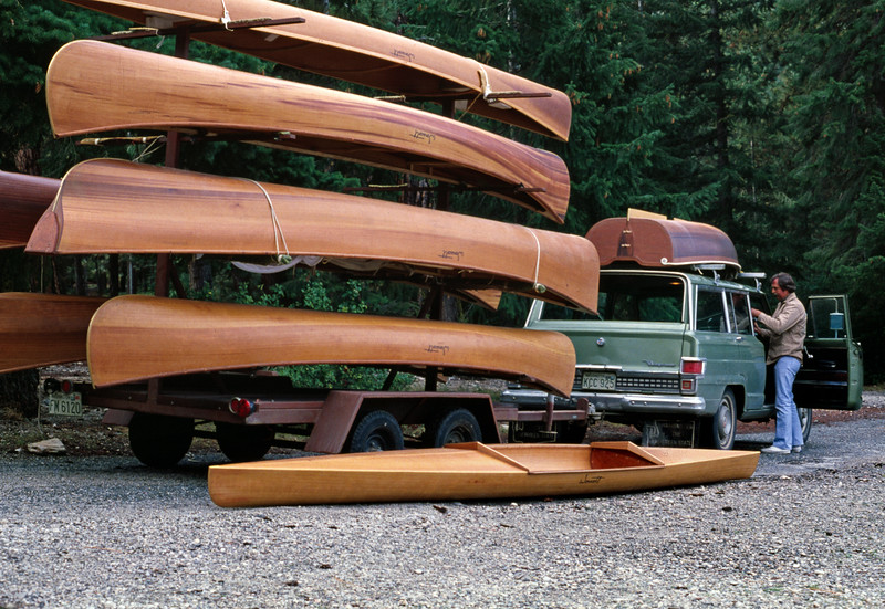 Ray Wonacott unloading cedar strip boats from a trailer for the Wonacott picnic. Lake Wenatchee, Washington. August or September 1978.