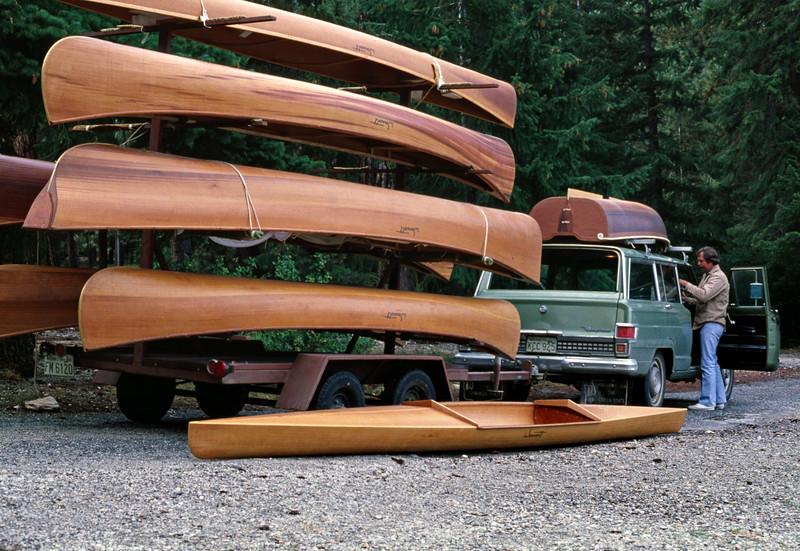 Ray Wonacott unloading cedar strip boats from a trailer for the Wonacott picnic. Lake Wenatchee, Washington. August or September 1978.