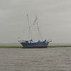Guanahani Aground in Jekyll Creek. During gale force winds of an extended NorthEaster, a sail unfurled and dragged the vessel out of the Golden Isles Marina Anchorage through St. Simons Sound, down Jekyll Island, and into Jekyll Creek where she finally grounded on the Jekyll Creek Jetty behind the front range marker even with her anchor in tow. Ungrounding by TowBoatUS Brunswick. Image 05-21-09