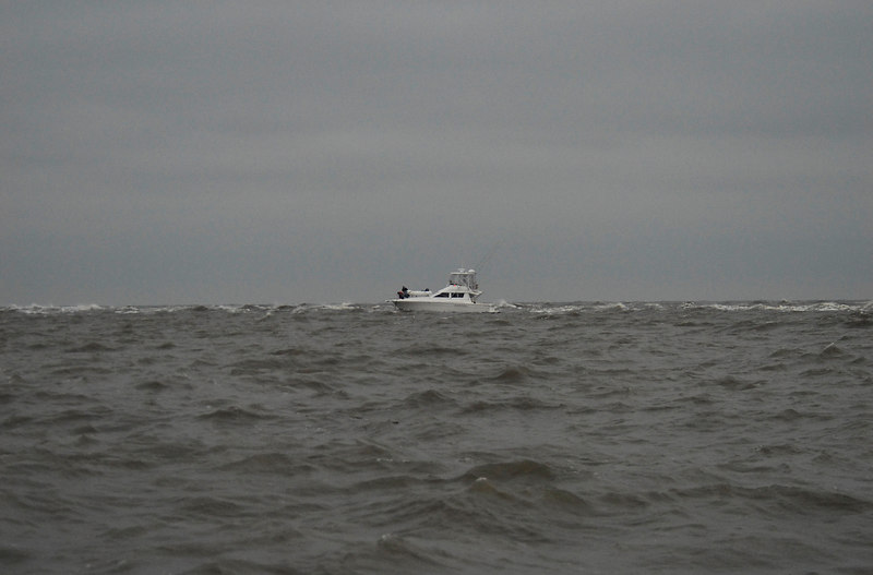 Sport Fishing Boat being towed off of shoal off of the northern end of Little Cumberland Island, Georgia. One tow boat almost sank during the rescue.