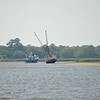 "Sea Hawk Shrimp Boat Sunk on Sandbar near Valona and Brunswick, Georgia just off the Intracoastal Waterway (ICW). Motor yacht ""The Bar-B"" is anchored behind. 05-08-09"