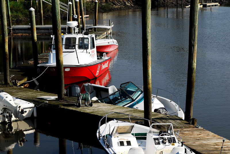 Sunken boat at the dock at Troupe Creek Marina in Brunswick, GA. Salvage by TowBoatUS Brunswick